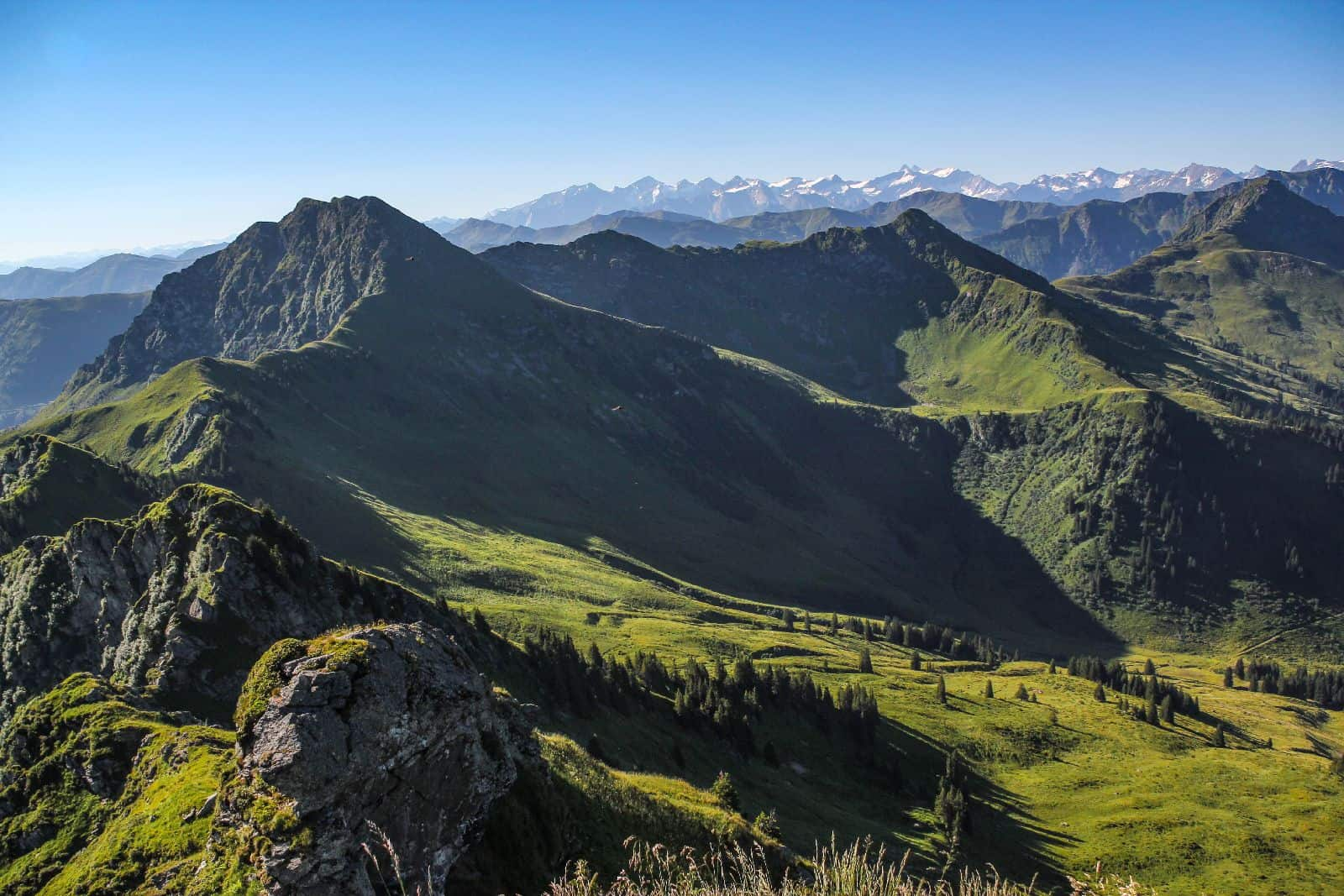 Panoramic view of summits in the austrian alps - Kitzbuehel, Tyrol, Austria_shutterstock_1121325947.jpg